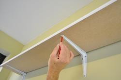 Marking fixing points on shelf